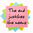 Proverb &quot; The end justifies the means &quot; written on bunch of stic - Lizenzfreies Foto