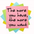 Proverb &quot; The more you have, the more you want &quot; written on bunc - Lizenzfreies Foto