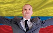 Biznesmen szczęśliwy z powodu zyskowną inwestycję w columbia s — Zdjęcie stockowe