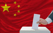 Man voting on elections in china — Stock Photo