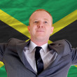 Happy businessman because of profitable investment in jamaica st — Stock Photo