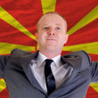 Happy businessman because of profitable investment in macedonia — Stock Photo