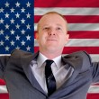 Happy businessman because of profitable investment in america st — Stock Photo