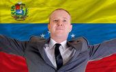 Happy businessman because of profitable investment in venezuela — Stock Photo