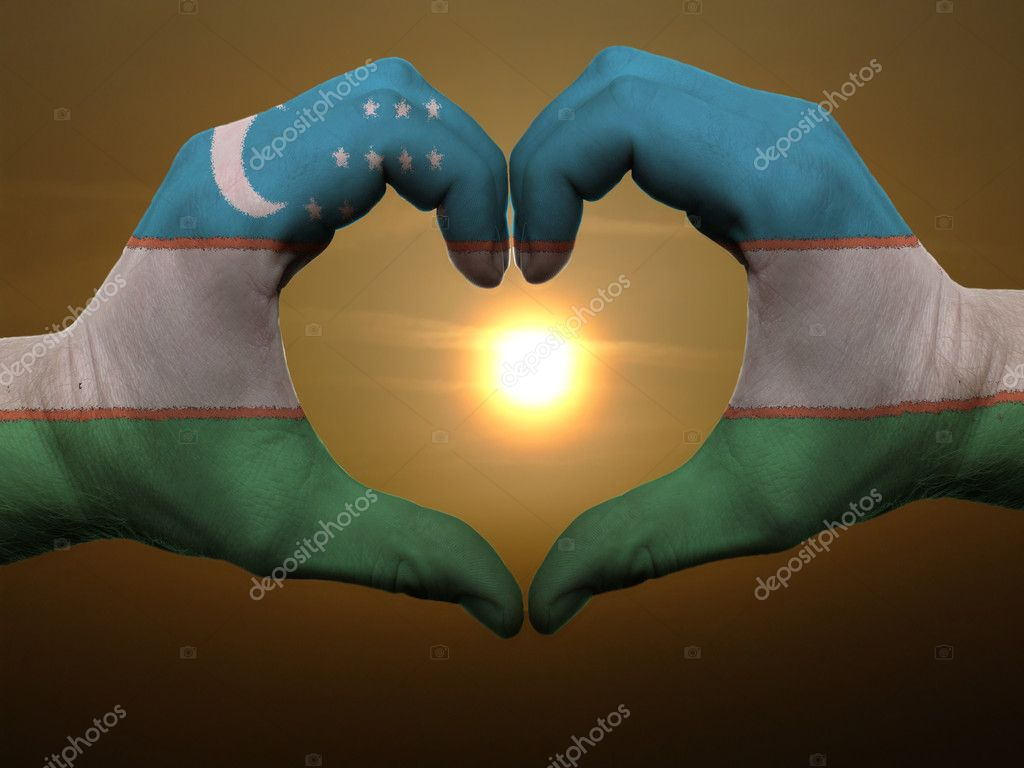 Gesture made by uzbekistan flag colored hands showing symbol of heart and love during sunrise — Stock Photo #7857186