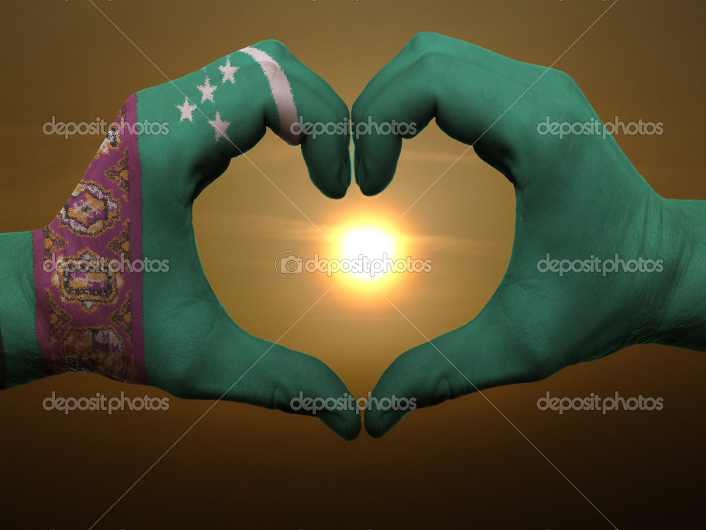 Gesture made by tunisia flag colored hands showing symbol of heart and love during sunrise — Stock Photo #7857214
