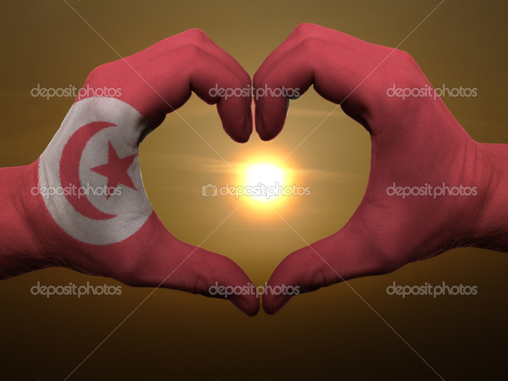 Gesture made by tunisia flag colored hands showing symbol of heart and love during sunrise — Stock Photo #7857229