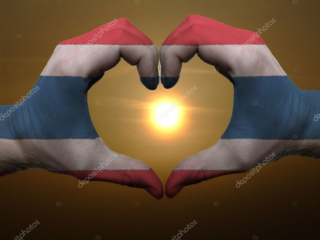 Gesture made by thailand flag colored hands showing symbol of heart and love during sunrise — Stock Photo #7857255