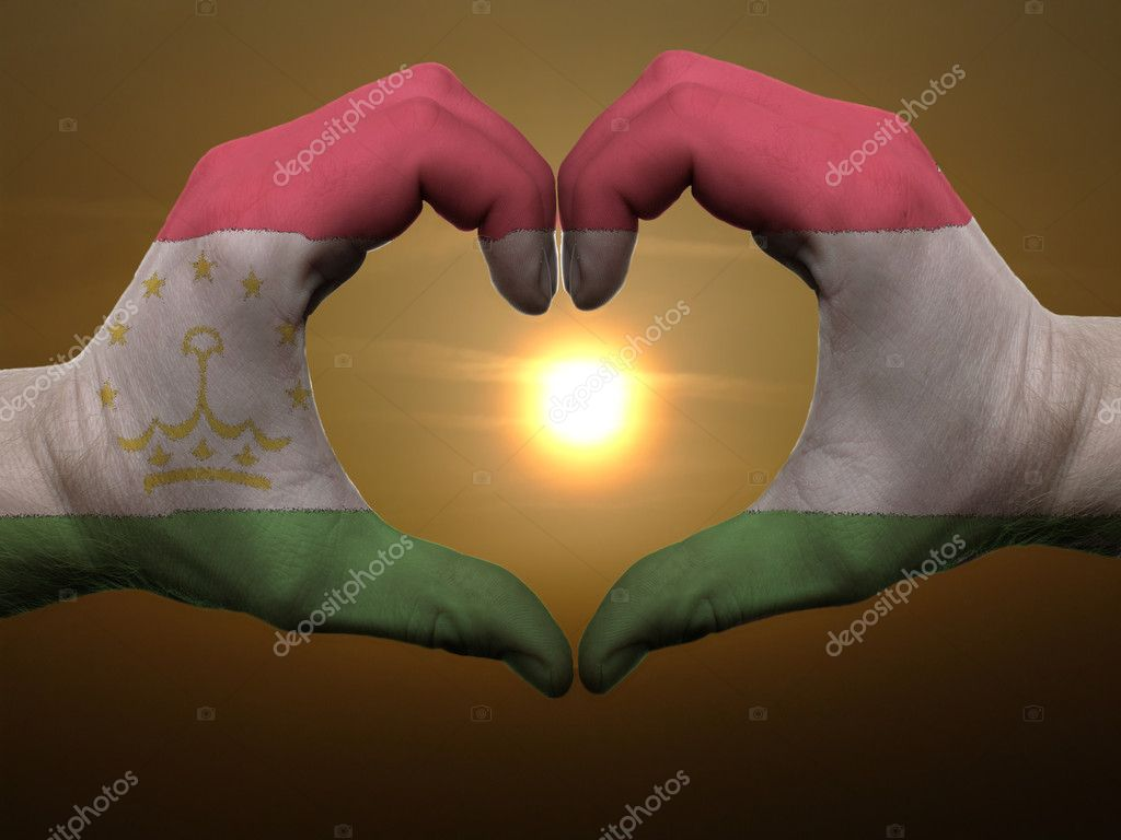 Gesture made by tajikistan flag colored hands showing symbol of heart and love during sunrise — Stock Photo #7857262