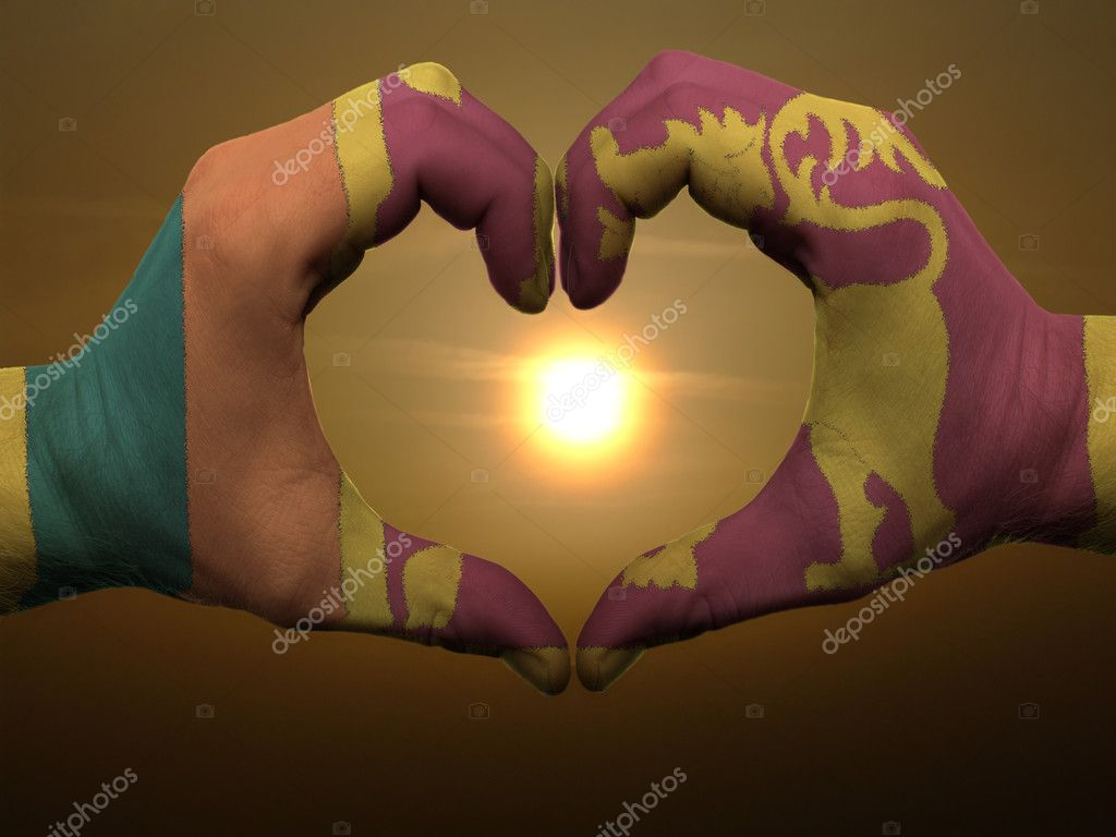 Gesture made by srilanka flag colored hands showing symbol of heart and love during sunrise — Stock Photo #7857297
