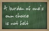 """"""" A burden of one's own choice is not felt """" written on a b — ストック写真"""