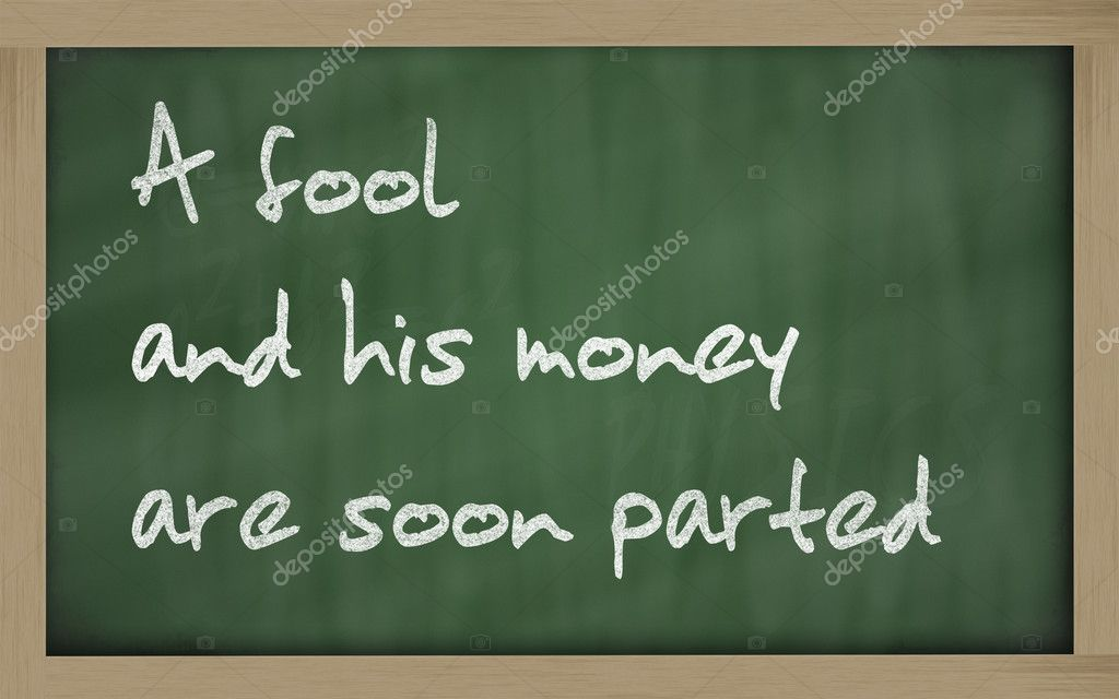 Blackboard writings   A fool and his money are soon (easily) parted   Stock Photo #7861518