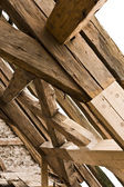 Wooden framework on ancient roof — Stock Photo