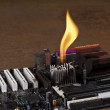 Melting heat sink on computer board - Stock Photo