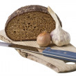 Brown bread on shelf with onion and garlic - Stock Photo