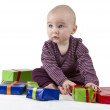 Young child unpacking presents — Stock Photo