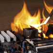 Burning computer main board - Stock Photo