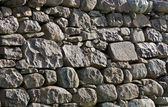 Stone wall in evening light — Stock Photo