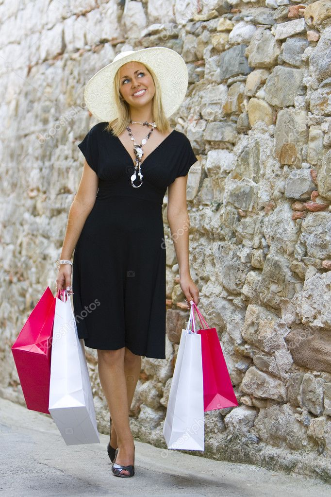 A stunningly beautiful wealthy young blond woman shopping in Europe with plenty of style — Stock Photo #6778757