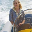 Beautiful Young Blond Woman Driving A Speedboat — Stock Photo #6790730