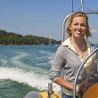 Beautiful Young Blond Woman Driving A Speedboat - Foto de Stock