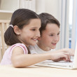 Boy & Girl Children Using Laptop Computer at Home — Stock Photo