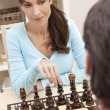 Beautiful Woman Playing Chess With Her Husband — Stock Photo