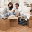 Family Unpacking Boxes Moving House — Stock Photo