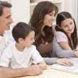 Happy Family Having Fun Using Laptop Computer At Home — Stock Photo