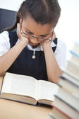Young School Girl Reading A Book — Stock Photo