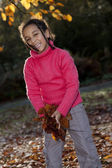 Beautiful Mixed Race African American Girl Playing With Fall Lea — Stock Photo