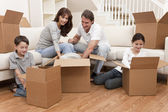 Family Unpacking Boxes Moving House — Stock Photo