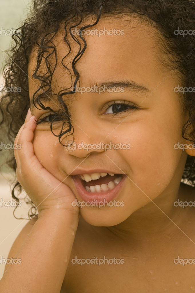 A beautiful mixed race girl with wet hair laughing at the camera — Foto Stock #6802510