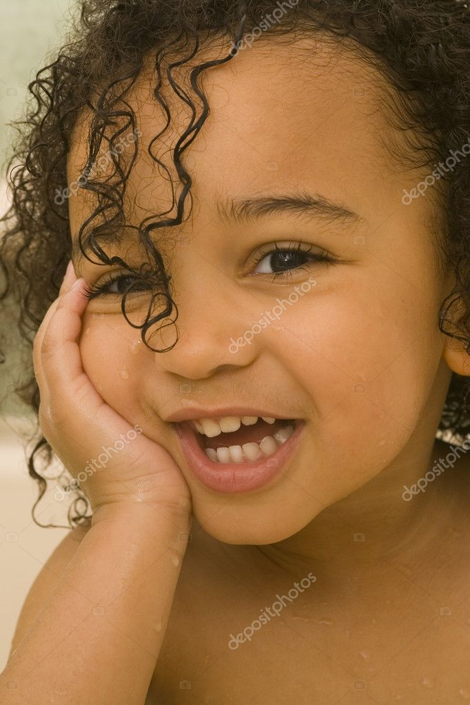 A beautiful mixed race girl with wet hair laughing at the camera  Stockfoto #6802510
