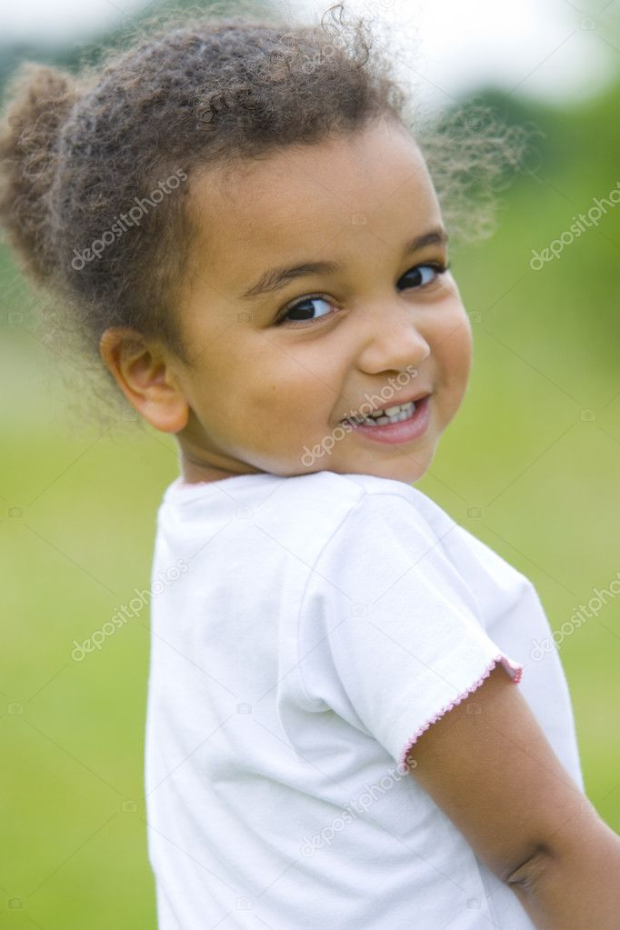 A beautiful mixed race girl looks back over her shoulder — Stock Photo #6802866