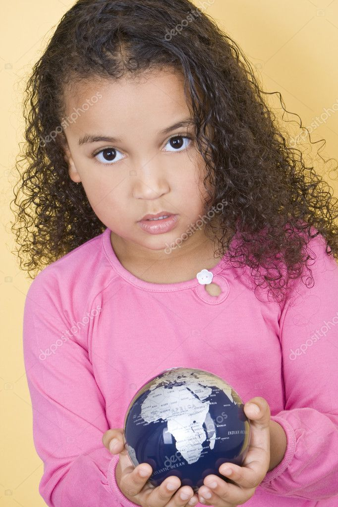 Environmental concept shot of a young African American child holding a globe  Stock Photo #6802897