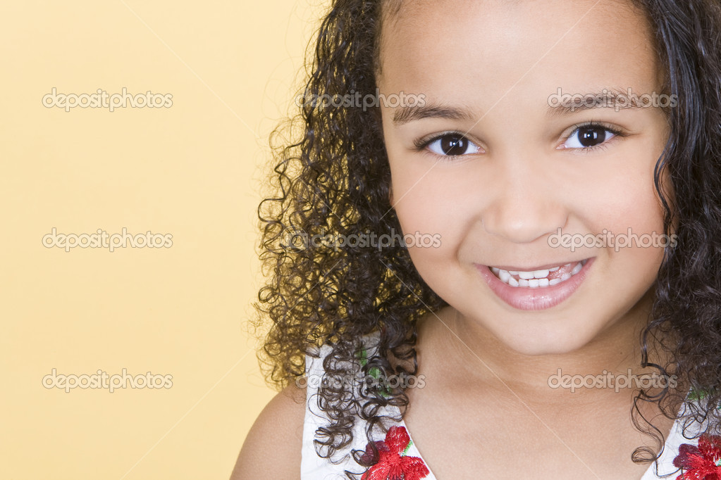 Studio shot of a beautiful young mixed race girl smiling — Stok fotoğraf #6802910