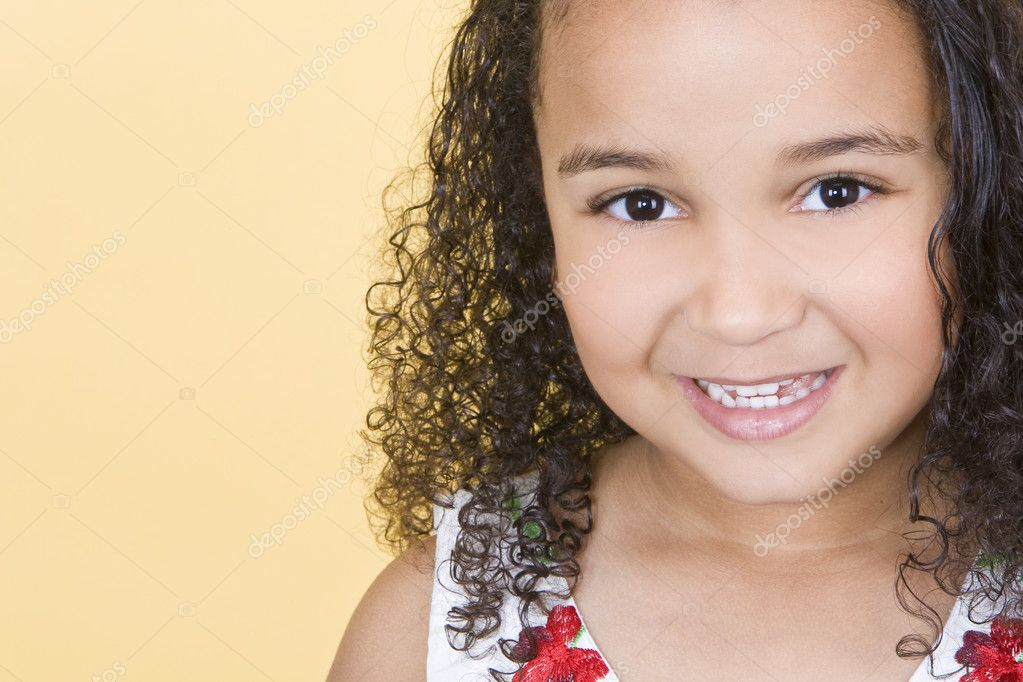 Studio shot of a beautiful young mixed race girl smiling  Stock Photo #6802910