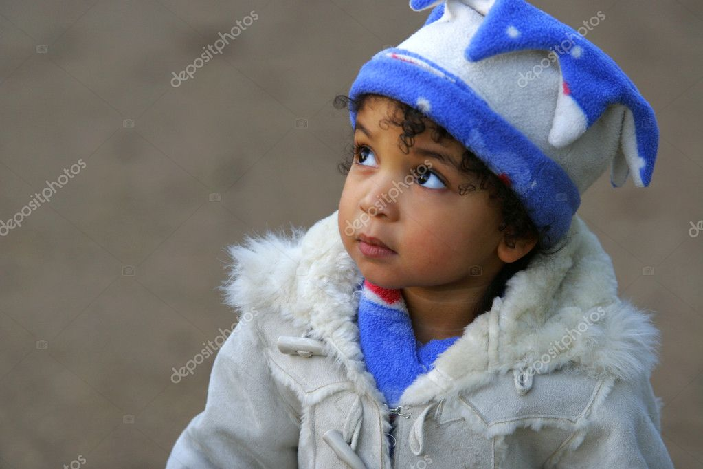 A young mixed race girl looks innocently upwards — Stock Photo #6802929