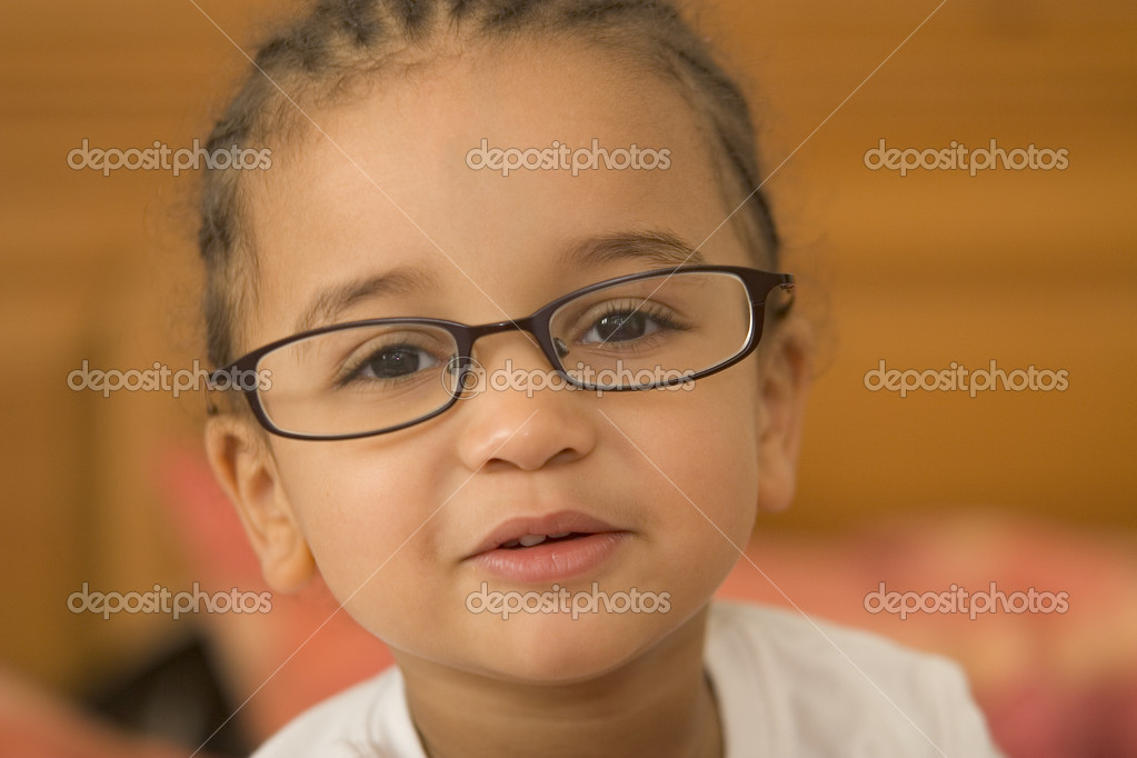 A beautiful young mixed race girl wearing slightly oversized glasses — Stock Photo #6802982