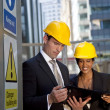 Male and Female Construction Site Managers Having A Meeting — Stock Photo