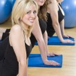 Stock Photo: Three Beautiful Young Woman Aerobic Exercising At A Gym