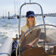Beautiful Young Blond Woman Driving A Speedboat — Stock Photo #6875378