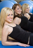 Three Beautiful Young Woman Aerobic Exercising At A Gym — Stock Photo