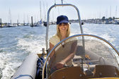 Beautiful Young Blond Woman Driving A Speedboat — Stock Photo