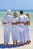 Two Couples Generations of Family Embracing on Tropical Beach — Stok fotoğraf