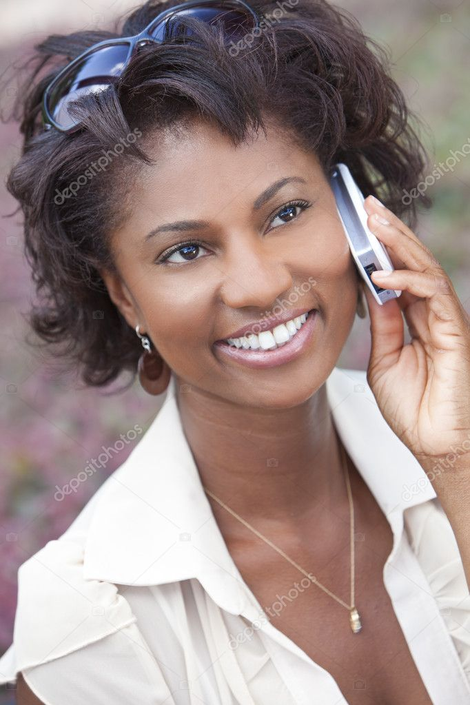 Beautiful Happy African American woman talking in her cell phone — Stock Photo #6875529