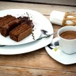Chocolate cake and cup of coffee — Stock Photo