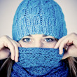 Beautiful girl with scarf hiding — Stock Photo #7023943