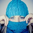 Beautiful girl with a scarf hiding — Stock Photo